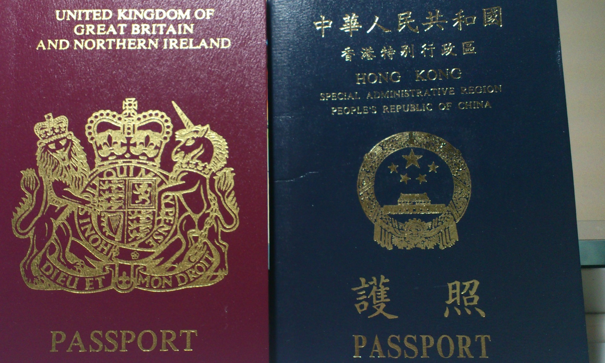 Hong Kong and British passports.