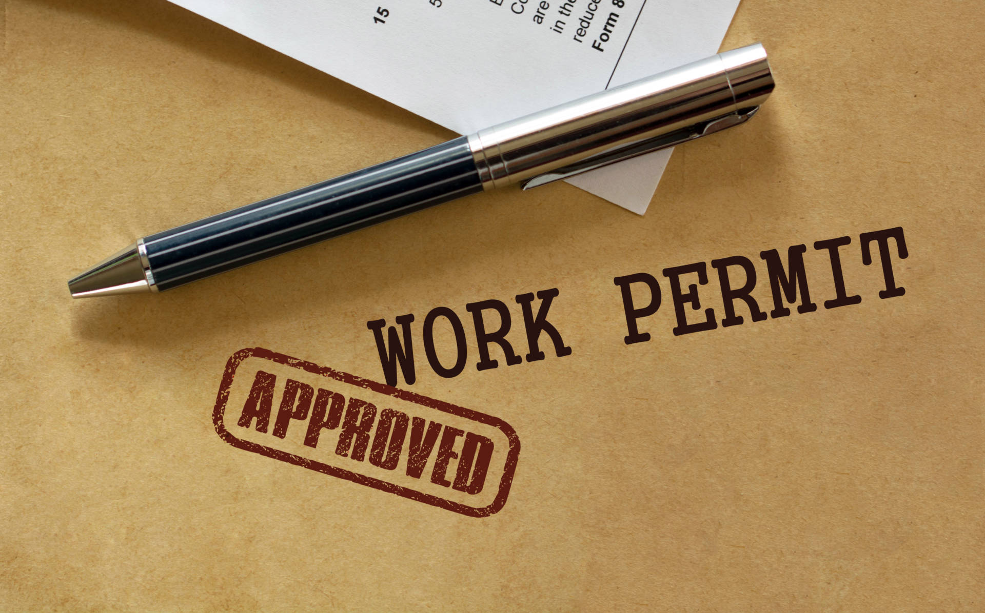 Approved work permit.